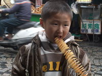 Click Here to view Some Kid eating Potato Chips in Full Size