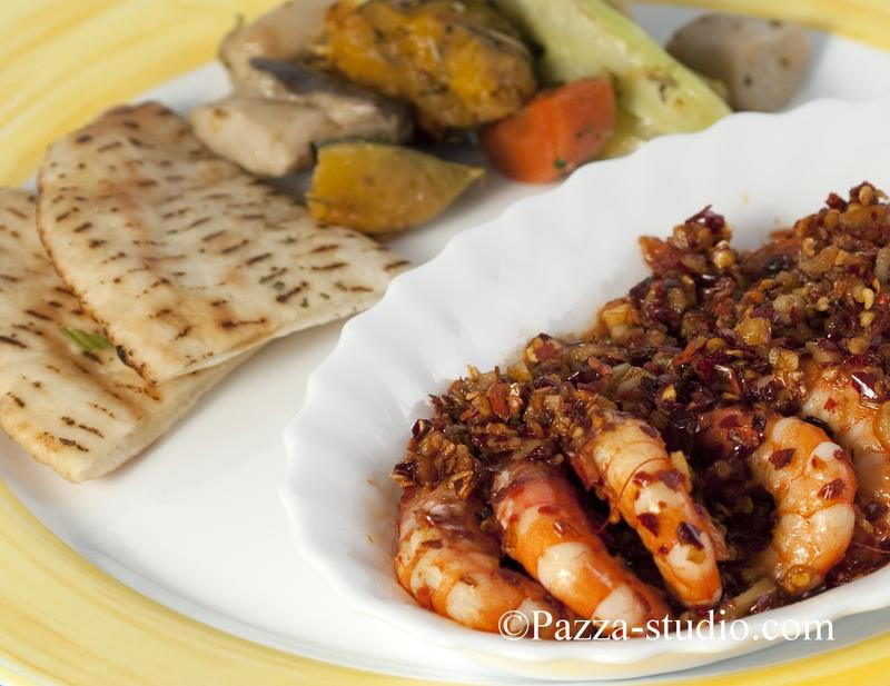 Pitta bread and spicy shrimps.