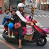 Mom and Three Kids on Scooter
