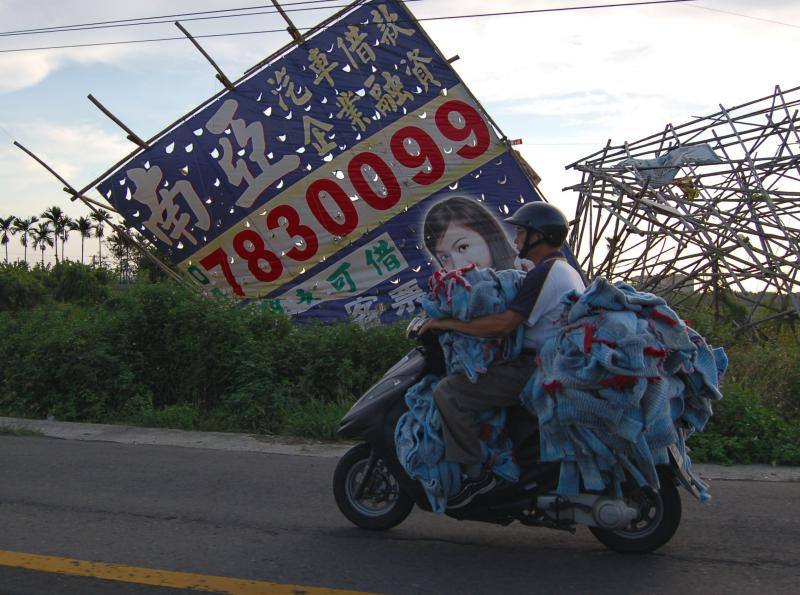 Man Carries 100's of Sweaters on Scooter
