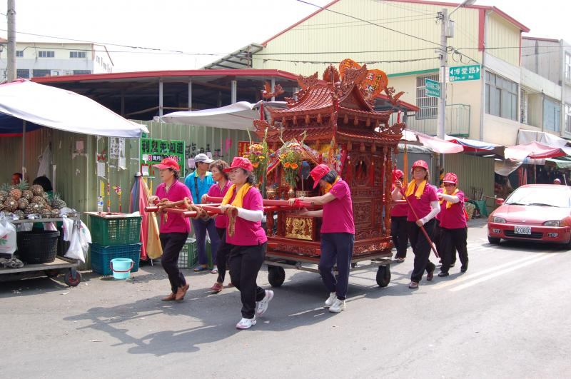 Worshippers carry the Matzu Temple Cart