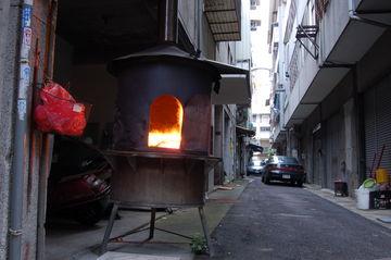 Ghost Money Burner in Alley